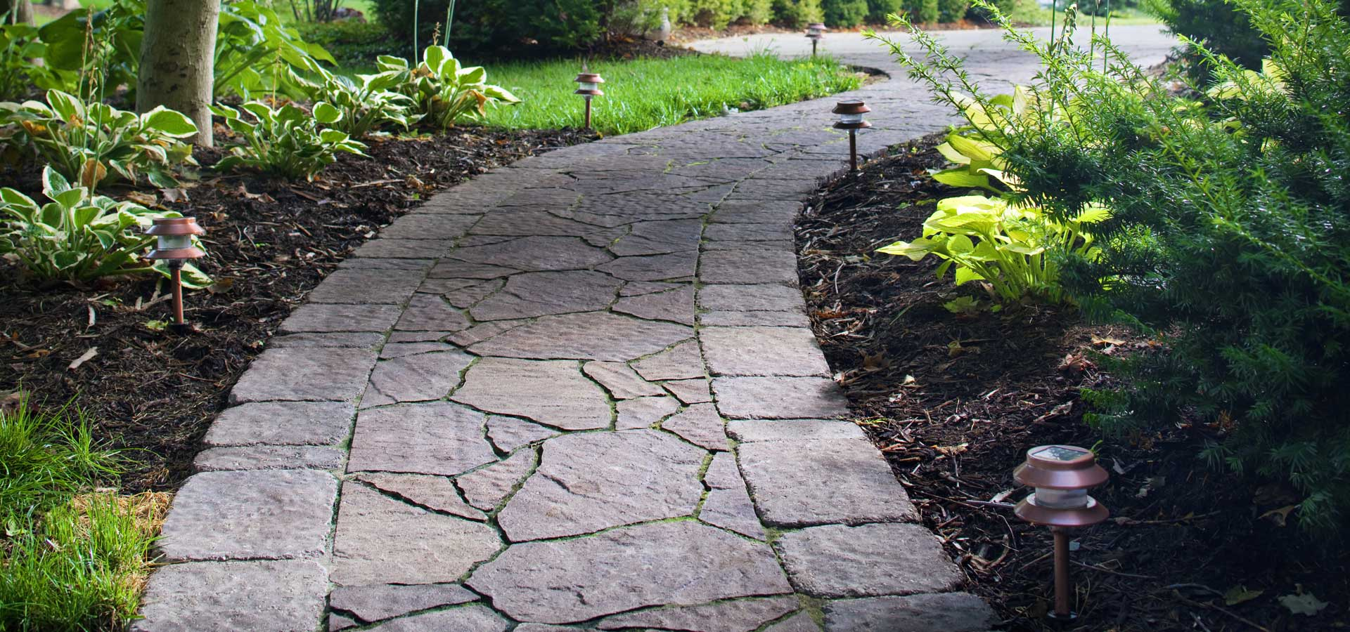 Beautifying your landscape with stone paver walkways for Walkway landscaping